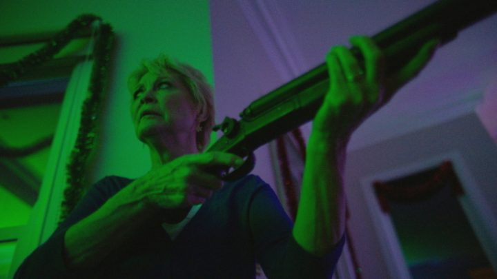 Dee Wallace Gun Green - Red Christmas Photo by Douglas Burgdorff 750